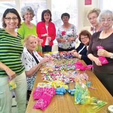 Members filling candy bags to be used for the Easters bags.