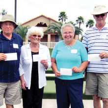 The first place winners of the second annual Sisk Park Bocce Club Tournament proudly hold their winnings: Tony Racano, Le Knecht, Nancy Vanderslice and Doc Heckler.