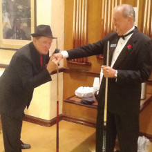 """Willie """"the Wizard"""" Foster, a/k/a """"The Consigliore,"""" kissing """"The Godfather's"""" ring worn by David """"The Godfather"""" Mork at the beginning of last year's tournament."""