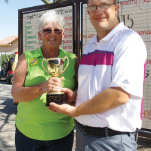 Greg Tokash, Palo Verde Head Pro, presents Jo Ann Hicks with the 2015 President's Cup Trophy. J. Ann shot a 113.