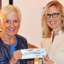 Penny Petersen presents a check to Daisy Steiner for the chILD Foundation
