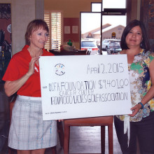 Betty Dupuis presents our contribution to The University of Arizona Foundation representative Sarah Gonzales