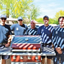 Sun Lakes firefighters from the Department's Station Two proudly pose with their new fire engine red BBQ grill.