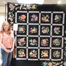 Jean NcMahon with her beautiful hand appliqued quilt; Jean is new to applique and this is her very first applique quilt. Bravo!
