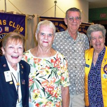 Lion Sally Hanson, who inducted Joan and James Loose into the club and Lion Pat Hollander, sponsor of these new members.