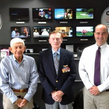 Pictured left to right are Paul Zimmerman from San Tan Rotary, WWII veteran Jack Holder and Orbitel Communications president John Schurz.