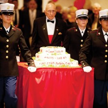 """""""Oldest Marine"""" Mike Harper, a Sun Lakes resident and WWII veteran, is escorted to the cake cutting ceremony."""