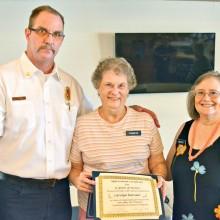 Deputy Chief Tim Kelly, Carolyn Barrans (15 years) and CAP Steering Committee member Betty Earp.
