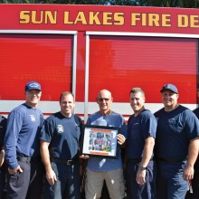 Pictured left to right are Battalion Chief Rob Helie, firefighter Brandon Johnson, Captain Cory Evans, Sun Lakes Anglers Vice President Doyne Cole, engineer Nate Van Briesen, firefighter Rich Mixer and firefighter Nate Stringfellow.