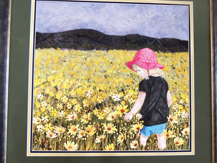 Penelope in Summer Flowers by Agave Quilter Nancy Kirk, who turned a personal photo into a stunning quilt using several art techniques.