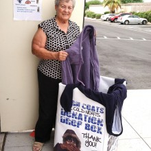 Betty Perry, chair of the Warm Coats Drive, preparing warm clothing to be donated to needy families.