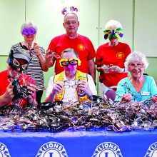 Volunteers have fun sorting and cleaning glasses
