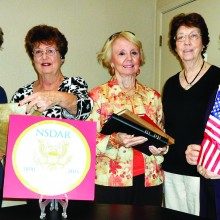 Pictured (left to right) Bonnie Clark, Barbara Hugus, Carolyn Hawkins, Jude Mente and Jan Hood with DAR 125 logo and symbols of history, education and patriotism.
