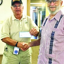 Jay Sanderson, Commander of Korean War Veterans Association, giving a monetary donation to the Stand Down Foundation, received by representative Art Sloan.