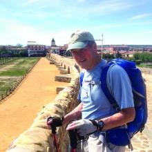 Brian Hill on a 13th century medieval bridge while hiking the Camino de Santiago in Spain.