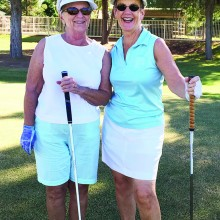 Vicki Carmichael and Nancy Dinkleman play golf in well coordinated, if spontaneous golf clothing!