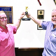 "Willie ""The Wizard"" Foster, Tournament Chairman, IronOaks, receiving the traveling trophy previously held by Mission Royale League from Conrad Lienes, Tournament Chair. Photo by David ""The Godfather"" Mork."
