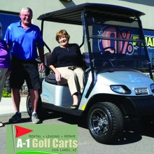 Colette McNally, President Sun Lakes Women's Association, Randy Peterson, General Manager A-1 Golf Carts and Susan Carew, winner.