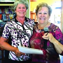 Judi Sloan receives her Hole-in-One winnings from President Karen Beltz