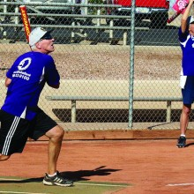 Gene Grandquist of the Mutual of Omaha team swings away at a recent contest. On deck hitter Bob Zawidski looks on. (Courtesy of Core Photography, LLC.)