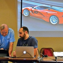 Bryan Beata, President of the Apple Users Group, and Kenneth Nelson discuss a new iPad feature at last month's meeting.
