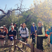 Hike Leader Vicki Deken talks about the life of an early pioneer buried along the trail.