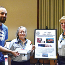 Apple Users Group of Sun Lakes (AUGSL) donates to the Sun Lakes Fire Department CAP Program. Present are Bryan Beata, President of AUGSL, Betty Earp and Nancy Roberts of the Community Assistance Program of Sun Lakes Fire Department.