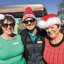Celebrating the season on December 17 were golfers (from left) Betty Ennis, Lorrie Morgan and Diana DePree of the Cottonwood Lady Niners.