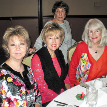 Attending the Lady Putter's Christmas lunch are (left to right) Merrilee Richardson, Carol Leavitt and Dianna Milkint; standing is Lynda Fallenberg.