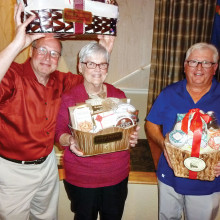 The January dance door prize winners from left to right are Tom Robinson, Sue Edwards and Don Hunt.