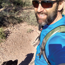 Greg Miller, owner of EZ Roll Out Shelves, and his dog, Dixie, out for a hike.