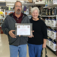 John Rivers, Manager of ACE Hardware in Sun Lakes, receives a plaque of appreciation from Sandra Whittenberg, Chairman of the Veterans and Family Service Program, Sun Lakes VFW Post 8053 Auxiliary.