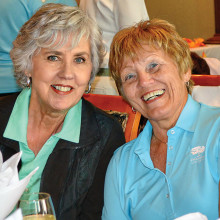 OLNGA members Marcy Griffith (left) and Suevonne Negaard socialize at a luncheon.