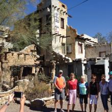 Roadrunners members Al Wilsey, Ruby Meyer, Jan Skibo, Julie Jarvi, Mary Rudolph and Leonard Meyer before Cabot's Pueblo in Desert Hot Springs