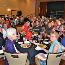 Capt. Cory Evans (center) and his table of ladies; Photo by Brian Curry