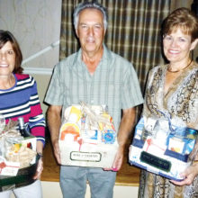 Door prize winners from left to right are Andrea Gilmour, Donald Dorge and Joyce Stefanick.