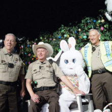 Members of the Sun Lake Posse Office that participated in the Easter Parade (left to right) J. Swanson, Vice Commander, R.Rubio, Exec. Officer, R. Burchett, Commander. Also participating in the Parade were C. Lloyd on the motorcycle, V. Romero, T.Tabaka and R. Young.