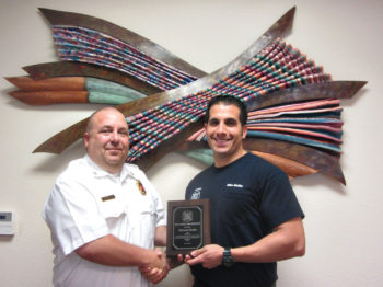 Sun Lakes Fire District Chief Troy Maloney (left) congratulates Captain Mike Molite on his 10th anniversary with SLFD. Molite holds an associate degree in fire science from Maricopa Community College and is an emergency medical technician. An acting engineer for seven years, he is an officer with his union SLERF (Sun Lakes emergency relief fund) and was promoted to captain in 2014. Prior to joining SLFD he worked in the emergency room at Chandler Regional Hospital. (Photo by LouAnn Sedgwick; caption by Brian Curry).