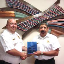 Sun Lakes Fire District Chief Troy Maloney (left) congratulates retiring Deputy Chief Dan Guerra for his service to Sun Lakes. Guerra rose through the ranks including a period when he served as interim chief of the district, but served most of his time as a battalion chief and then deputy chief for the last six years. Before serving in Sun Lakes he served in the Tri-City Fire District in Arizona where he served his last nine years there as assistant chief and also served in the TCFD as acting chief for a period. (Photo by LouAnn Sedgwick; caption by Brian Curry).