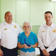 """Sun Lakes Fire District Chief Troy Maloney (left) and Deputy Chief Rob Helie (right) presented a token of appreciation plaque to the Sun Lakes Women's Association for their many years of support. Accepting the award for the association was President Collette McNally. Maloney thanked the women for their """"unwavering generosity and philanthropy with the Fire District and the Sun Lakes community."""" McNally commented that the SLWA was founded to help support the beginnings of what was then the Sun Lakes Fire Department when it was manned by all volunteers. (Photo and caption by Brian Curry),"""