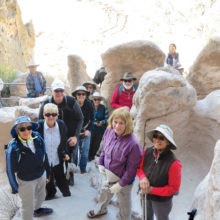Hikers exploring archeological site in Bandelier National Monument, NM