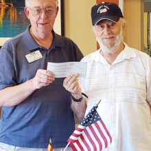 On behalf of the San Tan Crown Rotary Club, Tom Adamson made a financial presentation to Art Sloane of Arizona Stand-Down.