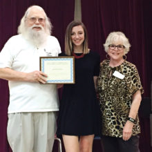 Roger Edmonds and Sandy Pallett presented Alli Halliday a check and a certificate at the last Sun Lakes Community Theatre meeting. SLCT is proud to support local theater in area schools.