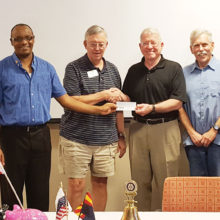 Shown here are club President Dan Albertson [left] and President-Elect Tom Adamson [left center] presenting a check representing the proceeds of the ride to Project Healing Waters Fly Fishing to Phoenix chapter Director Norm Johnson [center right] and Project Healing Waters volunteer and Hooked on Healing Veterans ride committee member Mark Pearlstein. Proceeds will be used to fund fly tying and rod building classes as well as monthly social gatherings for the veterans they support through the V.A.