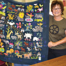 Nancy Kirk, Agave art group member, shows off her beautiful wool applique quilt.