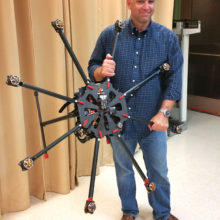 Doug Andriuk, President of the Phoenix Area Drone Users Group, was the featured speaker at the Sun Lakes Aero Club gathering March 21. Here he is shown with a giant drone he built from a kit (photo by J.R. Scheidereiter).