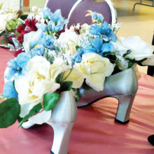 The Sun Lakes Women's Association had some pretty special decorations and door prizes at the Spring Luncheon on March 21. These were created with many pairs of beautiful fancy shoes and silk flowers – all donated items to the association.