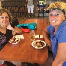 Curly Ferris and Debbi Ebel enjoying ice cream sundaes after league golf.