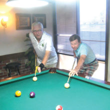 Lucky Shot Pool Club players Ed Allen (left) and Larry Stadler square off at the table.