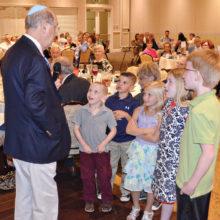 Rabbi Wiener tells the children about the hidden matzah